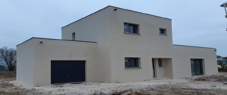 Construction de maison individuelle avec toit terrasse à Tresses